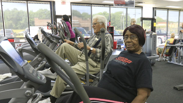 Shelby County residents Elvis Walton and Gladys Perkins are both in their 90s and work out two or three times every week at Snap Fitness in Columbiana. (Special to the Reporter/Dawn Harrison)