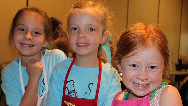 From left, Ella Grace Wheeler, Claire Olvia and Olivia Roberts enjoy the Thyme to Cook for Kids event at St. Vincent's One Nineteen. (Special to the Reporter/Lauren Thompson)
