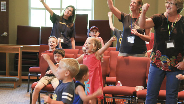 Children sing and dance during Celebration Time at Vacation Bible School on June 17 at Morningstar United Methodist Church in Chelsea. (Special to the Reporter/Dawn Harrison)