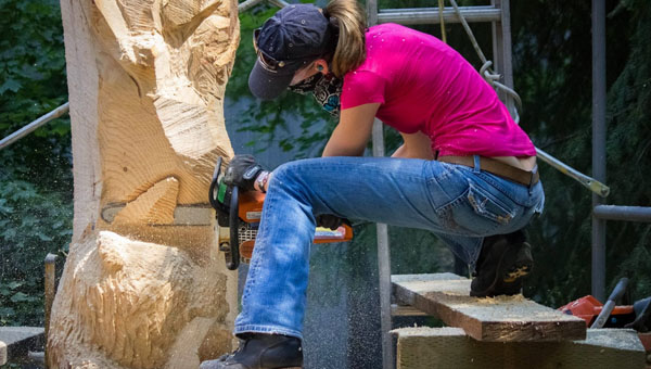 Woodcarver Heather Bailey uses a chainsaw to create one of her sculptures. (Contributed)