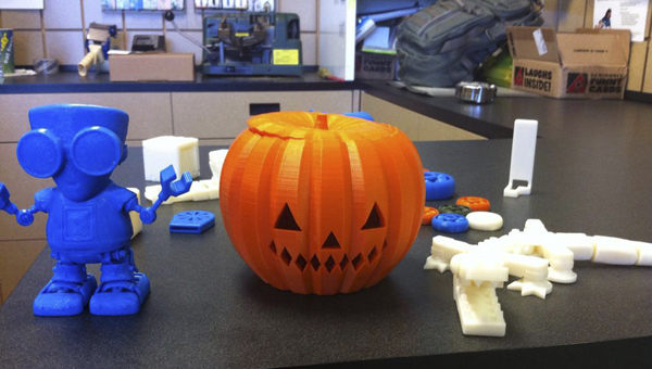 """The UPS Store on Caldwell Mill Road in Hoover has produced a variety of plastic objects with its 3D printer, including a pumpkin, a wrench and """"Fletcher,"""" the UPS Store's 3D printing mascot (left). (Contributed)"""