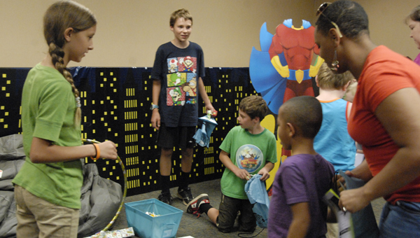 Kids who participated in the Pelham Library's summer reading program enjoyed a carnival themed party July 21 with games, food and balloon animals. (Reporter Photo/Jessa Pease)
