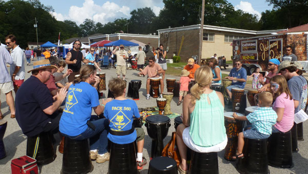 """Returning from last year's Shindig, """"Get Rhythm"""" with drummer John Scalici guides the public in an interactive rhythm drum circle. (Contributed)"""