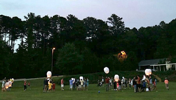 Prayer lanterns were released during the Asbury United Methodist Church's family picnic on July 10. (Contributed)