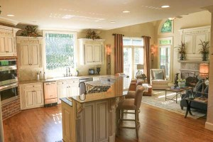 Cream cabinets and a brick oven adds warmth to the kitchen.