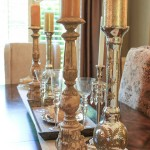 Metallic candleholders serve as the centerpiece in the dining room.