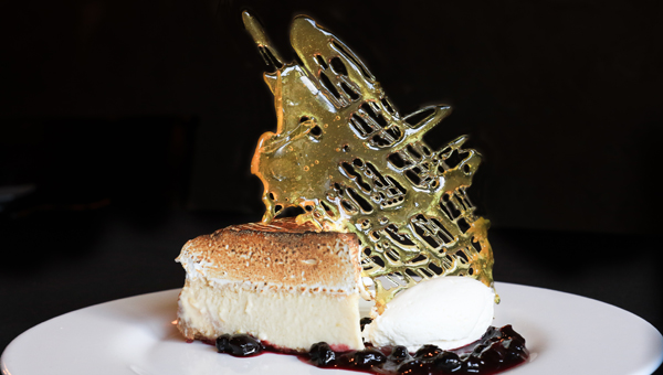 """Bellini's pastry chef Amber Croom works to create desserts that are """"art on a plate."""" (For the Reporter / Dawn Harrison)"""