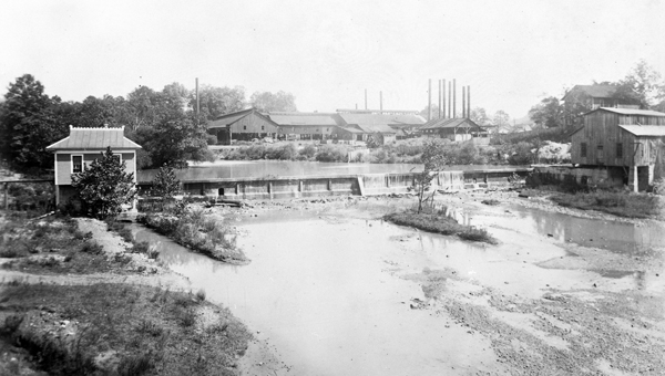 Helena History Panoramic View, Helena 1913. Helena became the envy of Shelby County before WWI. Connors-Weyman Steel Company produced 15,000 tons annually of hoops, bands and cotton ties; C.T. Davidson's turbines, in the building on the left, generated electricity lighting the town while his mill ground corn and wheat and ginned cotton. To top it all off, this photograph was taken from the vantage point of a new iron bridge spanning Buck Creek. (Contributed/City of Helena Museum)
