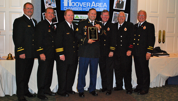 Michael Thorin, center, was given the Hoover Chamber Freedom Award during a July 16 Hoover Chamber of Commerce luncheon. (Reporter Photo / Molly Davidson)