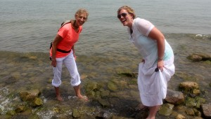 Inverness Vineyard Church members Nancy Pfau and Kim Frolander step into the Sea of Galilee. (Contributed)
