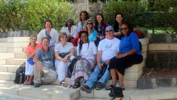 Twelve members of the Inverness Vineyard Church traveled to Israel for 13 days in June to learn about the country, culture and reflect on God and the Bible. The travelers posed for this picture while visiting the Mount of Beatitudes. (Contributed)