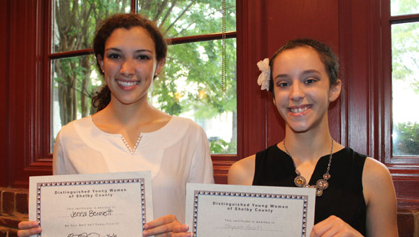 Jenna Bennett and Chyanna Rausch pose with their Distinguished Young Women writing and speaking awards. (Contributed)