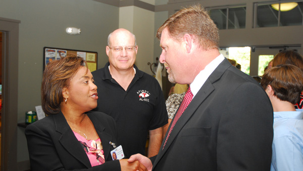 Alabaster City Schools personnel greet former Thompson High School Principal Chris Tangle, right, during a summer 2014 event. Tangle is now the principal at Demopolis High. (File)