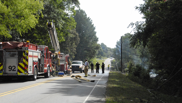 An accident involving a Honda Accord and an 18-wheeler claimed one fatality with three others hospitalized. (Reporter Photo / Jessa Pease)