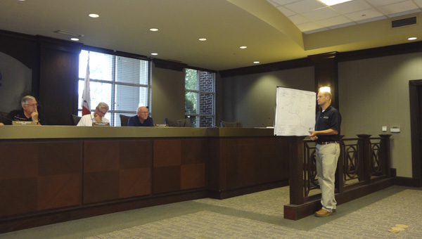 Ben Watson with InSite Engineering LLC shares plans for the proposed White Oak Manor subdivision off Shelby County 47 in Chelsea with the City Council on June 7. (Reporter Photo/Emily Sparacino)