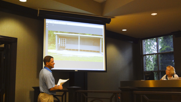 Keith Hager with Spencer Engineering in Birmingham shows the Chelsea City Council at a July 21 meeting an example of a dugout the city could use at its new sports complex off Shelby County 11. (Reporter Photo/Emily Sparacino)
