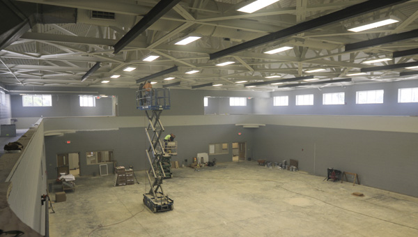 Crews work on the gym inside the Chelsea Community Center off Shelby County 47 on July 10. (For the Reporter/Dawn Harrison)