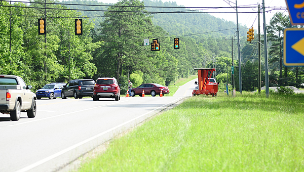 Police and road crews divert traffic at the intersection of Shelby County 52 and Shelby County 11 on July 8 after a traffic crash caused a large fire and evacuations on Shelby County 11 earlier. (Reporter Photo/Neal Wagner)