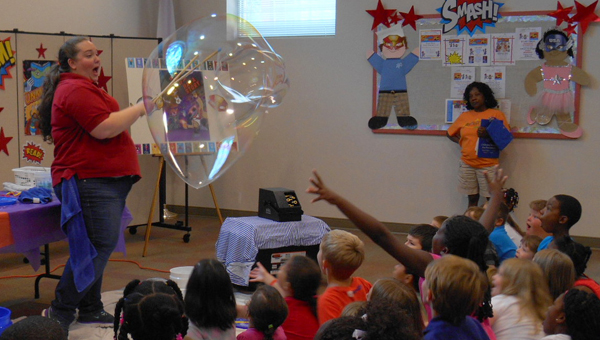 The science of bubbles was revealed during Lights, Action, Bubbles with Miss Kit at the Albert L. Scott Library in Alabaster this summer. (Contributed)