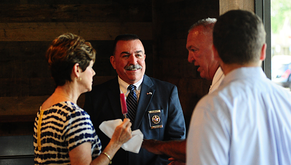 Shelby County Sheriff John Samaniego, center, talks with visitors at Alabaster's Frios Gourmet Pops on July 8. (Reporter Photo/Neal Wagner)