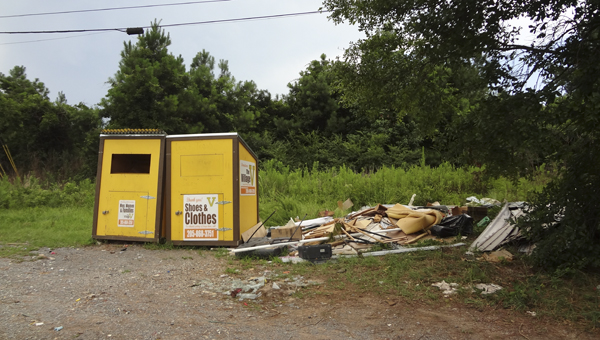Debris piled near donation boxes off U.S. 280 and Shelby County 39 in Chelsea has raised concerns from the city's residents lately. (Reporter Photo/Emily Sparacino)