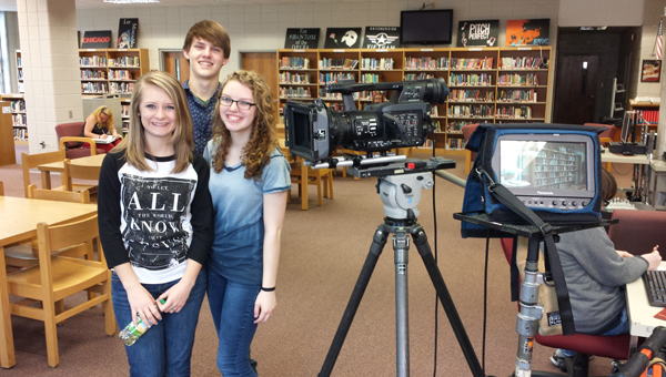 Breanna Noland, Ryan Harmon and Gabby Harmon, members of Peer Helpers at Shelby County High School 2014-2015, helped produce a video with the help of Gabby's father and Ryan's uncle, Ricky Harmon, SCHS Class of 1990, and SCHS sponsor, Dr. Jennifer Moore, on acceptance of peers. See video at Shelbyed.k12.al.us/schools/schs/students.html. (Contributed)