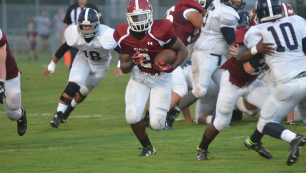 Shelby County running back Kevontae Mayfield finds open space in the Wildcats opener against Jemsion on Aug. 21. The Wildcats beat the visiting Panthers 42-6. (Reporter Photo / Baker Ellis)