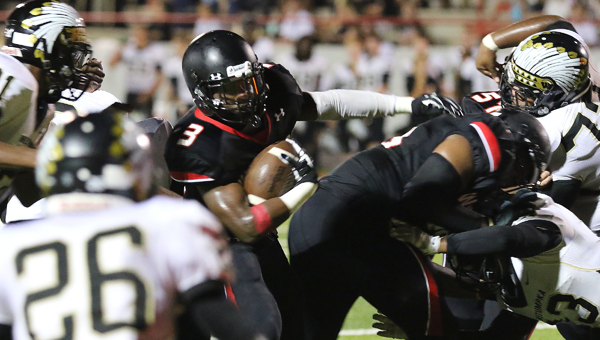 Carlos Stephens looks for space in Thompson's home opener against Wetumpka on Aug. 21. The Warriors won their first game since 2013 by a final score of 37-13. (Contributed / Eric Starling)
