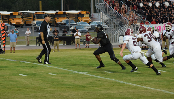 Helena senior running back Olford Ray blows past the Shelby County defense on his way to score one of his two rushing touchdowns on the night. (Contributed/Brian Vansant)