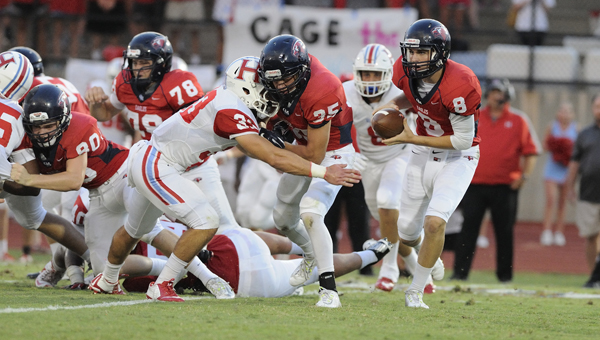 Wyatt Legas, 8, keeps the ball after faking to Coleman Reeves in Oak Mountain's Aug. 28 matchup with Hillcrest-Tuscaloosa. A shortstaffed Eagles team fell 31-0 at home in the season opener. (Contributed / Barry Clemons)