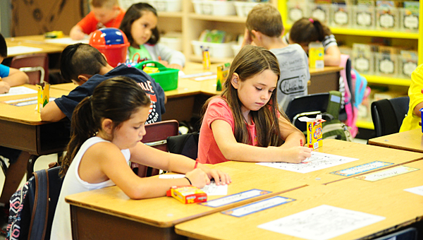Third-graders in Christie Wagner's class at Creek View Elementary School get settled into their desks as the first day of school starts on Aug. 13. (Reporter Photo/Neal Wagner)