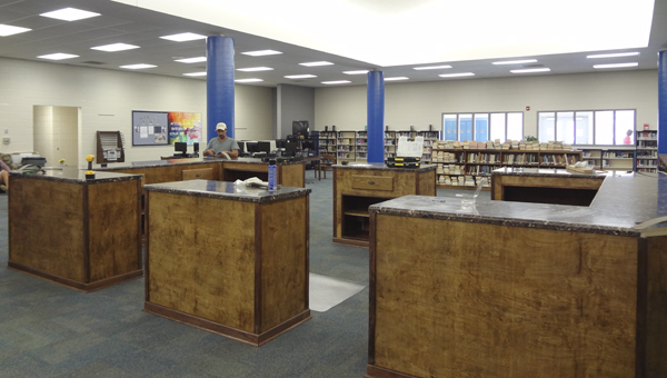 Chelsea High School's library features a new circulation desk, carpet and paint, and will have furniture and additions to the collection in the coming years. (Reporter Photo/Emily Sparacino)