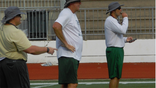 Tom Causey, far right, is entering his first season as the Pelham head coach. (Contributed)