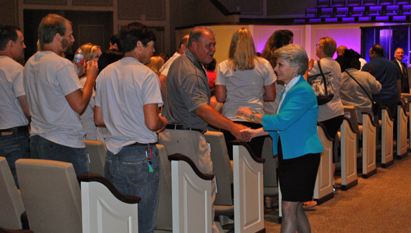 Hoover City Schools Superintendent Dr. Kathy Murphy shakes hands with teachers at Institute on Aug. 10. (Reporter Photo / Molly Davidson)