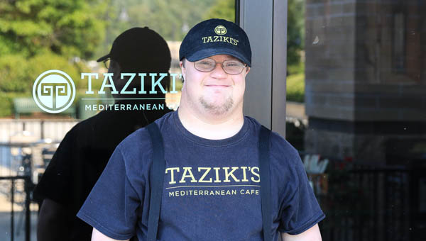 Mark McCallum takes a quick break from work to pose outside of Taziki's Mediterranean Cafe in Lee Branch on Aug. 14. (For the Reporter / Dawn Harrison)