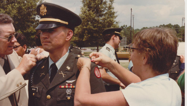 Gary Waters, mayor of Pelham, received his commission as a second lieutenant in June 1982. Pictured are Waters with his parents, CSM Herbert B. Waters, U.S. Army (Retired) and mother, the late Jean Pullen Waters, who pinned his lieutenant bars on him. (Contributed)