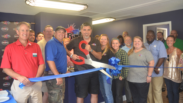 The South Shelby County Chamber of Commerce holds a ribbon-cutting ceremony for APH Radio in Alabaster on Aug. 10. (Reporter Photo/Jennifer Bailey)