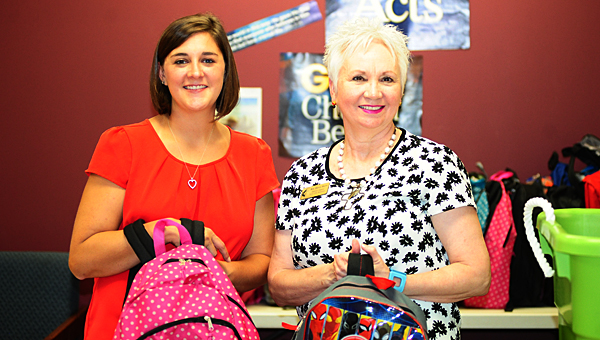 Alabaster First United Methodist Church member Meggie Collins, left, and Pastor Sherry Harris display backpacks collected for local children in need. (Reporter Photo/Neal Wagner)