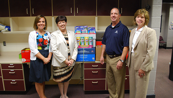 From left to right: Thompson Middle School Principal Neely Woodley poses for a picture with Alabaster-Pelham Rotary Club members Debbie Parrott, Alex Strange and Elizabeth Roland. The club donated free school supplies to TMS. (Reporter Photo/Graham Brooks)