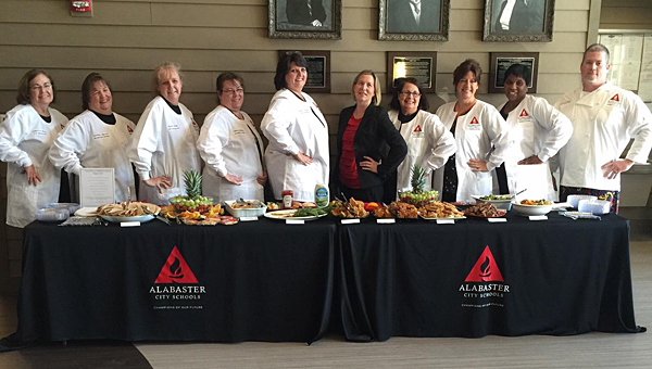 Members of the Alabaster City Schools child nutrition program staff prepare to showcase their new meal offerings before an Aug. 3 School Board meeting. (Contributed)
