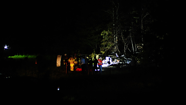 Emergency responders work the scene of a plane crash in a field slightly south of the Shelby County Airport on Aug. 27. (Reporter Photo/Neal Wagner)