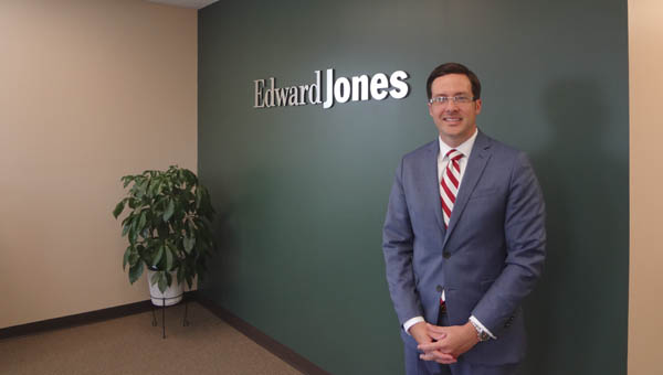 Kyle Mims opened his Edward Jones office on the second floor of the building that also houses Encore Physical Therapy in downtown Columbiana in June. (Reporter Photo/Emily Sparacino)