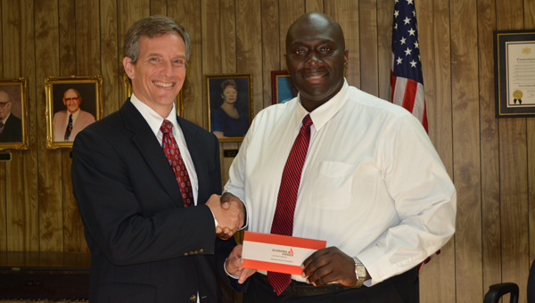 Harpersville Mayor Theoangelo Perkins accepts a Good Roots grant from the Alabama Power Foundation. The town will use the $1,000 grant to purchase crape myrtle trees for the town park. (Contributed)