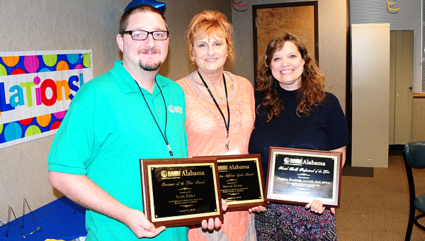 NAMI Shelby County supporters, from left, Scott Elder, Sherryl Treslar and Daphne Kendrick recently earned awards from the state NAMI organization. (Reporter Photo/Neal Wagner)