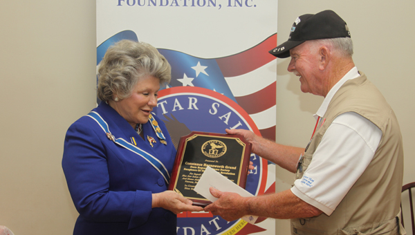 Lt. Col. R. Glenn Nivens, U.S. Army (retired), presents Alabama Daughters of the American Revolution State Regent Constance Haynsworth Grund 2012-2015 with a plaque of appreciation for her service. (Contributed)