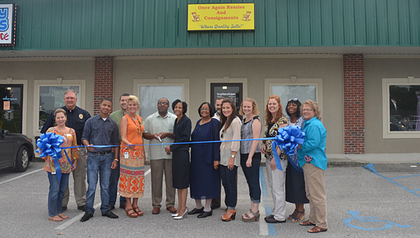 Store owners, Greater Shelby County Chamber of Commerce and Alabaster officials hold a ribbon-cutting ceremony at Once Again Resales and Consignments on Aug. 7. (Reporter Photo/Jennifer Bailey)