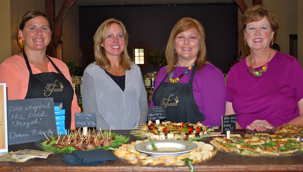 Donna Roberts, left center, stands next to Simply Infused owner Cheryl Harper, right center, at a book signing event in Mt Laurel on Aug. 28. (Reporter Photo / Molly Davidson)