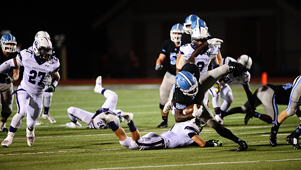 Spain Park running back Larry Wooden (25) stays upright after avoiding a Hueytown defender in the Jaguars' home win over the Golden Gophers on Aug. 28. (Reporter Photo/Neal Wagner)