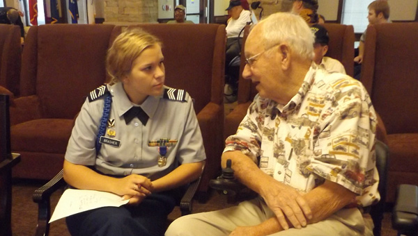 Cadet Riley Brasher of Vincent High School JROTC program listens intently to Army veteran Howell Dulaney, who shares his experiences in WWII about landing on Utah Beach on D-Day and fighting in Gen. George Patton's Third Army during the Battle of the Bulge. (Contributed)