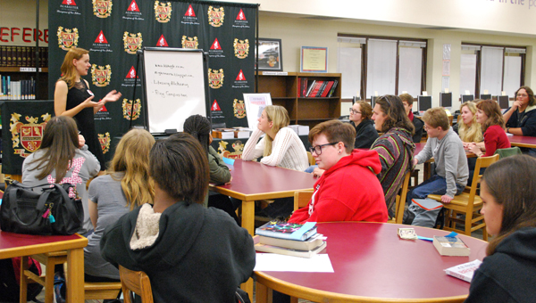 K.B. Hoyle talks to a group of Thompson High School students in the school's library on Nov. 23. (Reporter Photo / Molly Davidson)